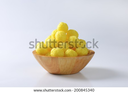 heap of corn pops in the wooden bowl - stock photo