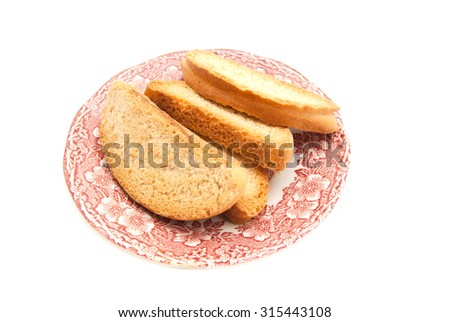 heap of crackers on a plate on white  - stock photo