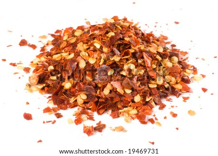 Heap of crushed chili isolated on white, macro lens used