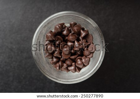 heap of dark chocolate chip in glass - stock photo
