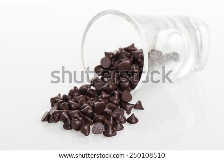 heap of dark chocolate chip on white background - stock photo