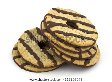 Heap of delicious chocolate striped cookies isolated on white background. - stock photo