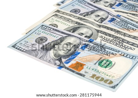 Heap of 100 dollar bills on the right side isolated on white background. Business concept - stock photo