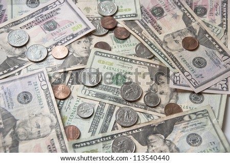 heap of dollars and coins money - stock photo