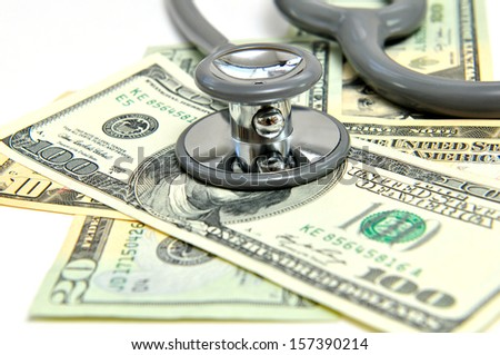 heap of dollars with stethoscope - stock photo