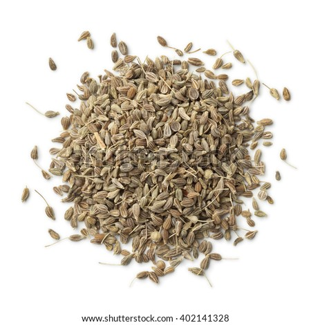 Heap of dried anise seeds on white background