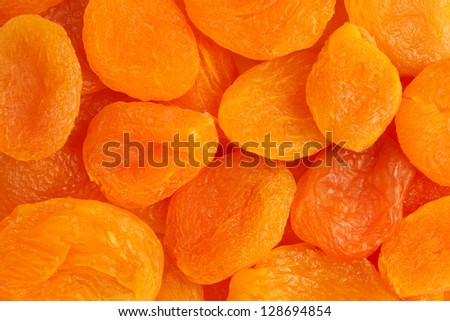 Heap of dried apricots close-up. - stock photo