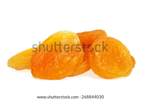 Heap of dried apricots on a white background