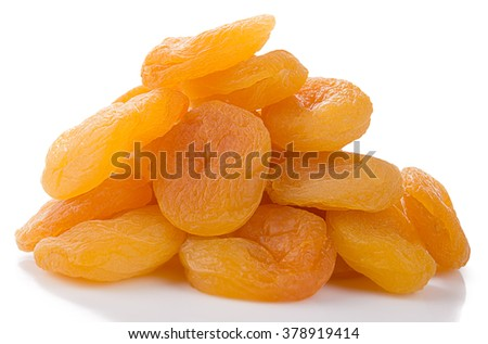 Heap of dried apricots on white background. - stock photo
