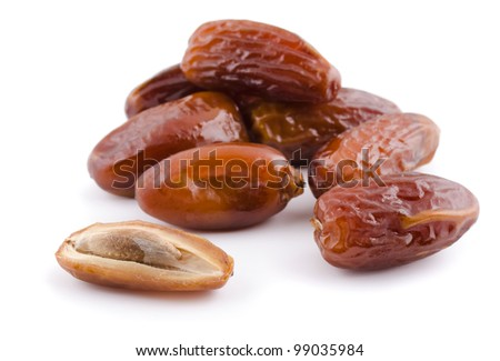 Heap of dried date fruit isolated on white - stock photo