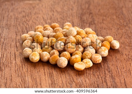 heap of dried peas on wooden background, closeup - stock photo