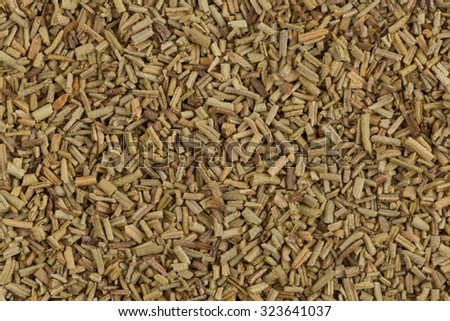 Heap of dried rosemary on a white background