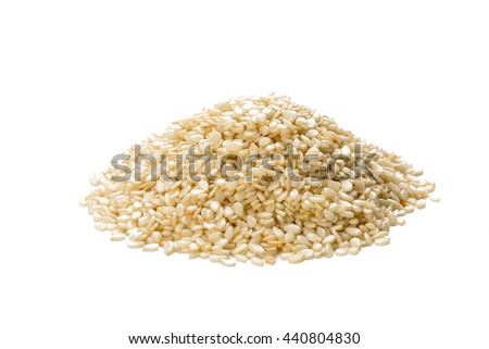 Heap of dried sesame isolated on white background, front view, closeup. - stock photo