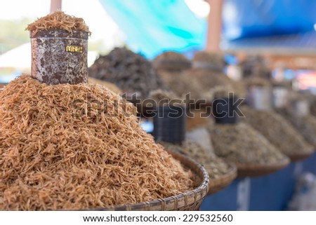 Heap of dried small sized fishes for sell in indonesian market. Selective focus. - stock photo