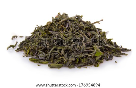 Heap of dry green tea isolated on white background  - stock photo