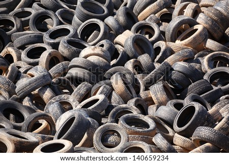 Heap of dumped old car tires - stock photo