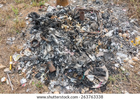 heap of fired kitchen garbage on ground - stock photo