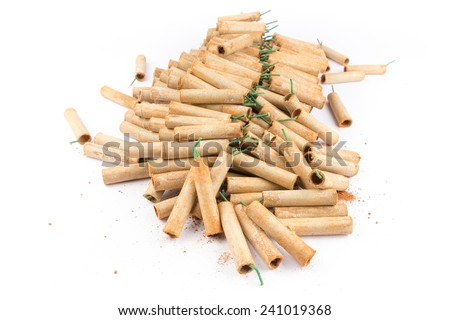 Heap of firework crackers isolated on white background - stock photo