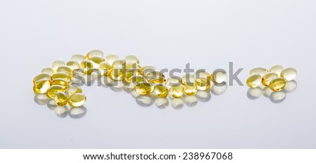 Heap of fish oil Omega 3 capsules isolated on a white background - stock photo