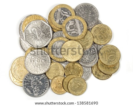 heap of french francs money coins and centimes in different values isolated on white, top view, ancient french currency - stock photo