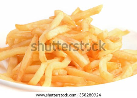 Heap of French fries from fast food shop on white backgrounds
