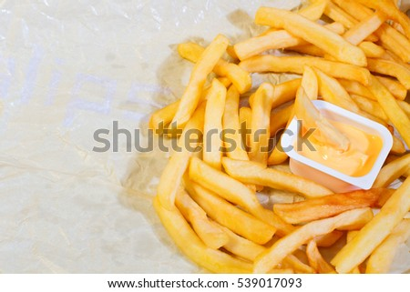 Heap of french fries with cheese sauce