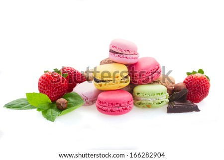 heap of french macaroons with ingredients  isolated on white background - stock photo