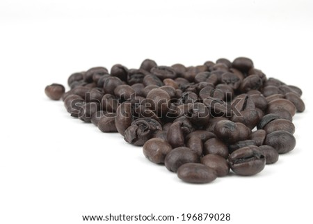 Heap of fresh coffee beans - stock photo