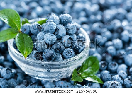 Heap of fresh harvested Blueberries (with water drops) - stock photo