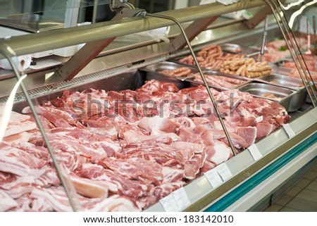 Heap of fresh raw meat food flesh background at shop supermarket - stock photo