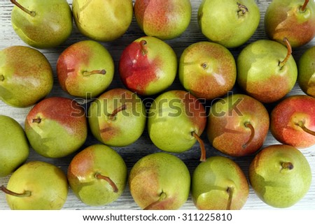 Heap of fresh ripe pears close up - stock photo