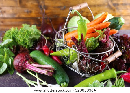 Heap of fresh vegetables on table close up - stock photo