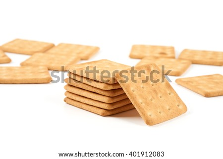 Heap of freshly baked cookies isolated on white background