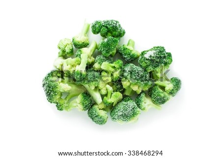 Heap of frozen broccoli isolated over white, top view - stock photo