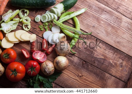 Heap of fruits and vegetables on wooden background.