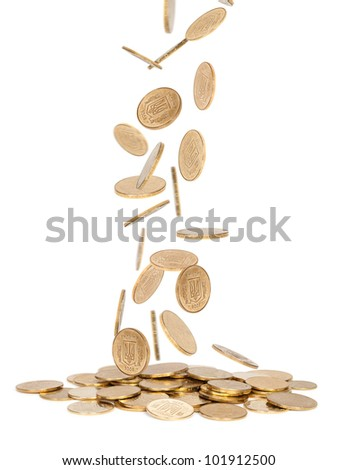 Heap of gold  coins falling to the ground - stock photo