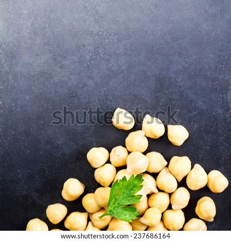 Heap of Golden Chick peas close up on dark background with blank copyspace for your text.  Chickpeas - Traditional  Food macro  - stock photo