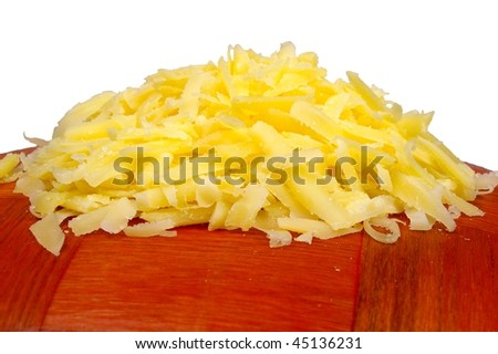heap of grated cheese on wooden surface isolated - stock photo