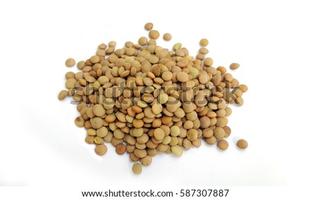 Heap of green lentil on white background
