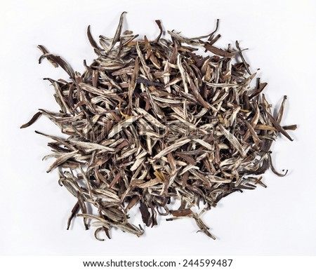 Heap of green tea leaves on a white background