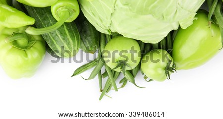 Heap of green vegetables isolated on white