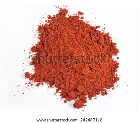 Heap of ground paprika on a white  - stock photo