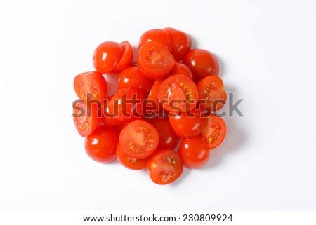 heap of halved cherry tomatoes - stock photo