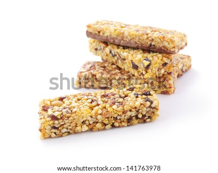 Heap of healthy cereal muesli bars on white background - stock photo