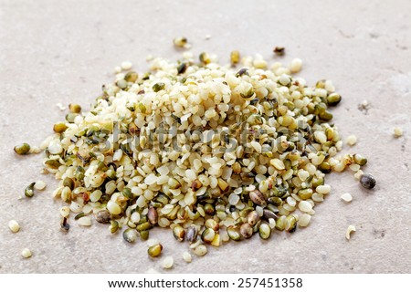 heap of hemp seeds on kitchen table - stock photo