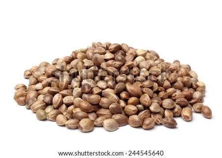 Heap of hemp seeds on white backround - stock photo