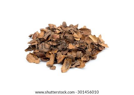 Heap of loose empty cacao shells isolated on white background - stock photo