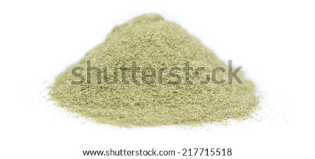 Heap of Lovage Powder (close-up shot) isolated on white background