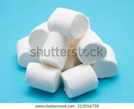 heap of marshmallow on blue - stock photo