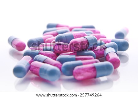 Heap of medicine pills. Close up of colorful tablets and capsules - stock photo